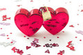 Two hearts locked, with small decorations Royalty Free Stock Images