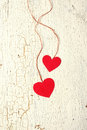 Two hearts made ​​of paper on a wooden background red old Stock Photography
