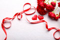 Two hearts, red ribbon and beautiful roses Royalty Free Stock Photo