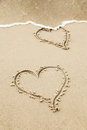 Two hearts in the sand of a beach hand drawn Royalty Free Stock Photography