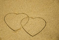 Two hearts on sand drawn the sandy beach Stock Photography