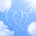 Two hearts shapes in the sky made from planes traces Royalty Free Stock Image