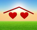 Two hearts under a home roof Stock Photography