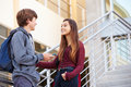 Two High School Students Standing Outside Building Royalty Free Stock Photo