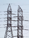 Two high tension power line towers Royalty Free Stock Photo