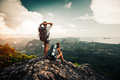 Two hikers relax on top of a mountain Royalty Free Stock Photo