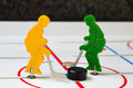Two hockey players fight with puck in center Royalty Free Stock Photos