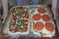 Two Home Made Pizzas on the Way to the Oven Royalty Free Stock Photo