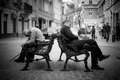 Two homeless men sleep th of march ukraine lviv outside on the benches Stock Photo