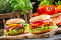 Two homemade burgers made ​​from fresh vegetables closeup of on old wooden table Stock Photo