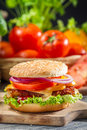 Two homemade burgers made ​​from fresh vegetables on old wooden table Royalty Free Stock Photo
