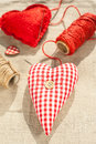 Two homemade sewed red cotton love hearts couple heart indoor closeup Stock Photo