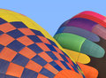 Two hot air balloons inflating colorful being inflated blue sky in background Royalty Free Stock Photography