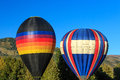 Two hot air balloons with trees. Royalty Free Stock Photo