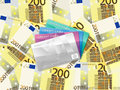 Two hundred euro background and credit card cards on banknotes Stock Image