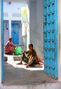 Two indian women are working outside his home udaipur india november in udaipur india nov Stock Images