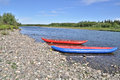 Two inflatable canoes on the shore of north river polar ural komi republic russia Stock Image