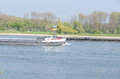 Two inland waterway on the rhine meet a ship on uphill drive and the other on plummeting Royalty Free Stock Photo