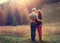 Two inlove young people on the sunset forest glade Royalty Free Stock Photo