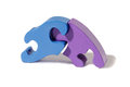 Two interlocking puzzle pieces in blue and purple conceptual of problem solving and solutions Stock Photos