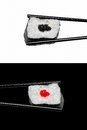 Two japan sushi roll chopsticks isolated white black background Royalty Free Stock Photo