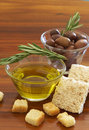 Two jars of black olives and olive oil Royalty Free Stock Photo