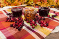 Two jars of cranberry sauce with cranberries on a table apple relish Royalty Free Stock Image