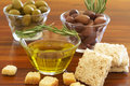 Two jars of green and black olives and croutons Stock Photo