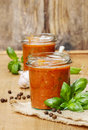 Two jars of tomato sauce bolognese sauce on wooden table Stock Image