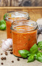 Two jars of tomato sauce bolognese sauce on wooden table Stock Photos