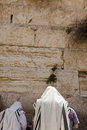 Two jewish men wearing jewish praying shawls standing parying infront wailing wall old city jerusalem Stock Images
