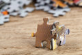 Two jigsaw puzzle pieces on table concept of teamwork a joint together shallow depth of field Royalty Free Stock Photo