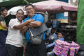 Two jovial burmese men yangon myanmar october fun arguing over something stop to smile for the camera in a street in yangon Stock Photos