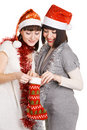 Two joyful girls taking out their christmas presen Stock Images