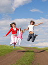 Two jumping women and one little girl Stock Photo