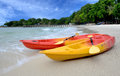 Two kayaks on the beach of the island Royalty Free Stock Photo