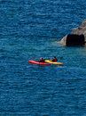 Two kayaks on lake superior near cliffs Royalty Free Stock Photos
