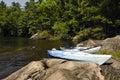 Two kayaks rocky shoreline northern lake Royalty Free Stock Photos
