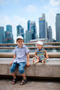 Two kids in big modern city Stock Photos