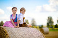 Two kids, boy and girl in traditional Bavarian costumes in wheat field Royalty Free Stock Photo