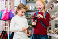Two kids buying toys in toy store Royalty Free Stock Photo