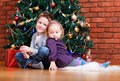 Two kids at Christmas Royalty Free Stock Images