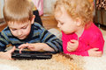 Two kids with digital tablet Royalty Free Stock Photography