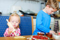 Two kids helping to bake pie Royalty Free Stock Photo