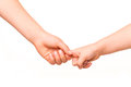 Two kids holding hands together. Stock Image