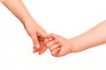 Two kids holding hands together. Royalty Free Stock Photography