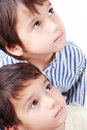 Two kids looking up Stock Images
