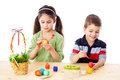 Two kids painting easter eggs Stock Photo