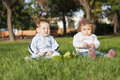 Two kids in the park laying on grass Royalty Free Stock Images