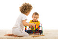 Two kids playing home brother and sister with wooden toy Royalty Free Stock Photos